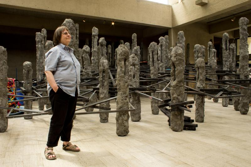 "Artist  Phyllida Barlow with her sculpture ""Scree Stage"" during the first few days of its 10 day assembly in the Des Moines Art Center's I.M. Pei Gallery."