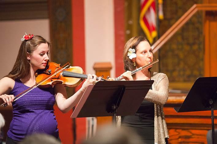 Members of Cedar Valley Chamber Music Emily Osinski (violin) and Michelle Cheramy (flute) in performance.
