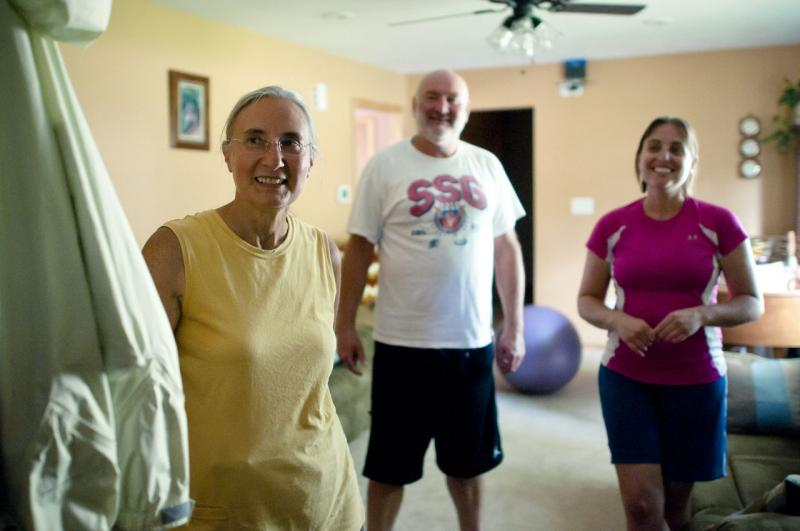 Betty, Fred Jr. and Sara Phelps in their home in Topeka, KS. June 2011.