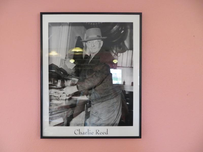 Lights reflect on the Charlie Reed photo hanging in the diner. Reed was the farmer who started the business.