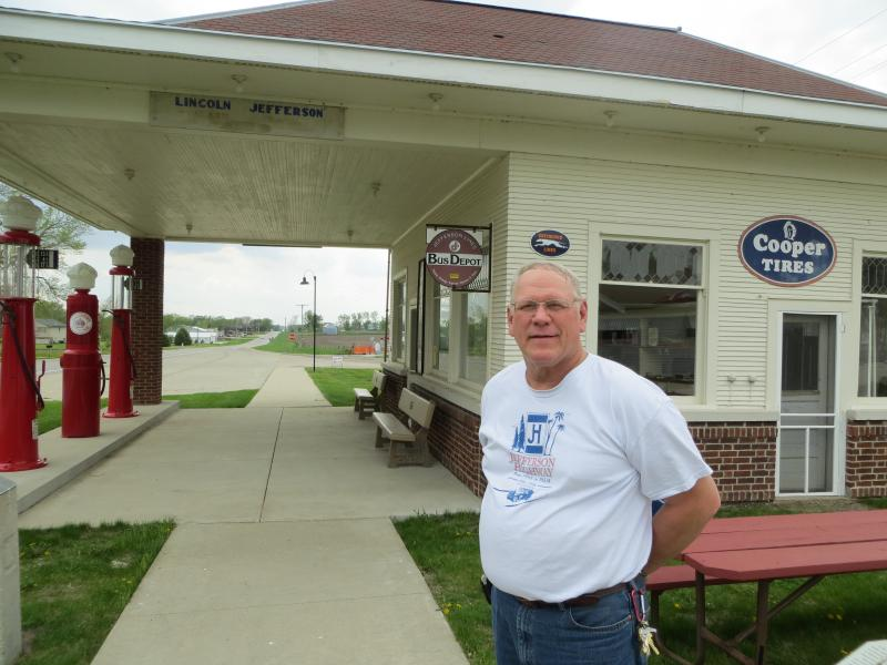 Scott Berka, standing in front of the 1928 Standard Station where he worked as a teenager.