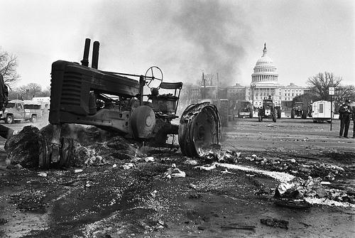 Farmers from across America marched for the second year in a row to protest against the U.S. Department of Agriculture in Washington, D.C. on February 5, 1979. An old tractor is burned in effigy in protest.