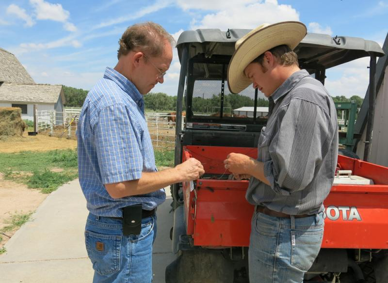 William Burnidge, left, an ecologist with the Nature Conservancy, is working with rancher Nathan Andrews to test out a different method of grazing.