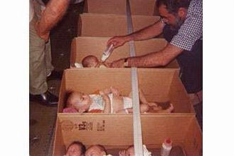 Boxes of babies are strapped in a C5A cargo plane in 1975.