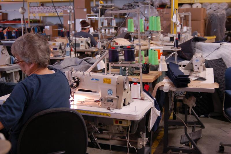 Inmates working on sewing machines at the Mitchellville Prison Industries warehouse