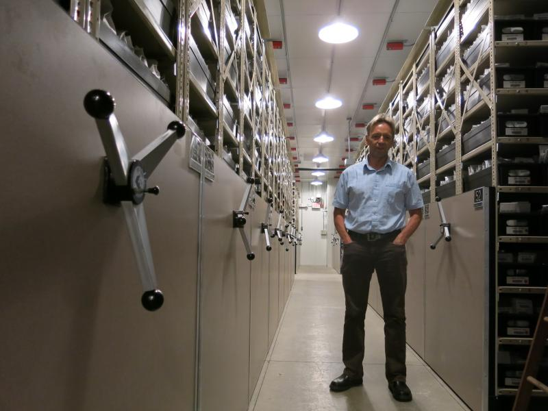 Dave Dierig, research leader at the National Center for Genetic Resources Preservation, stands among the ceiling-high shelves that hold the 600,000 seed packets in this cold storage vault.