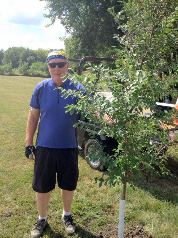 Dave Cooney plants a tree in every overnight community as a way to say thank you.