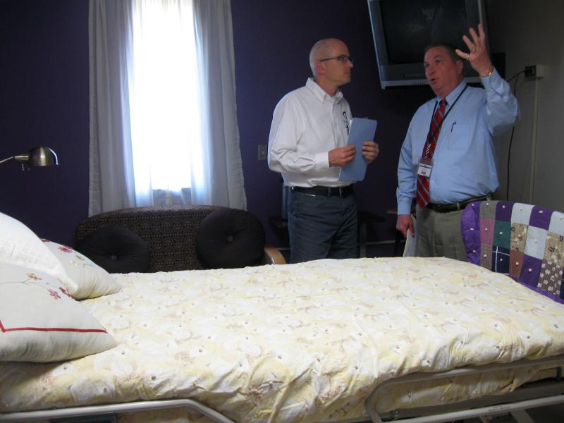 Host Ben Kieffer gets a tour of a prison hospice room with Deputy Warden Greg Ort