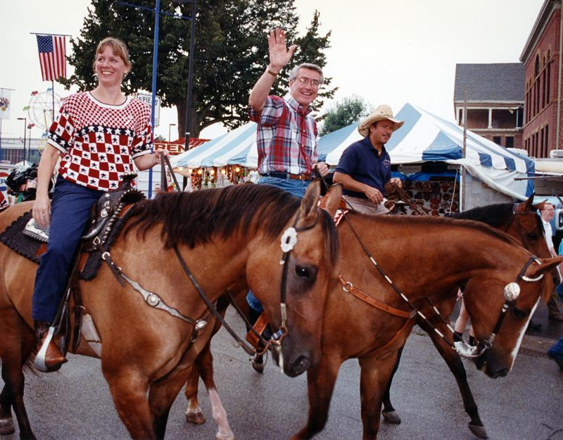 As state secretary of agriculture, Becky Doyle and Gov. Jim Edgar, center, ride through the 1991 Illinois State Fair.
