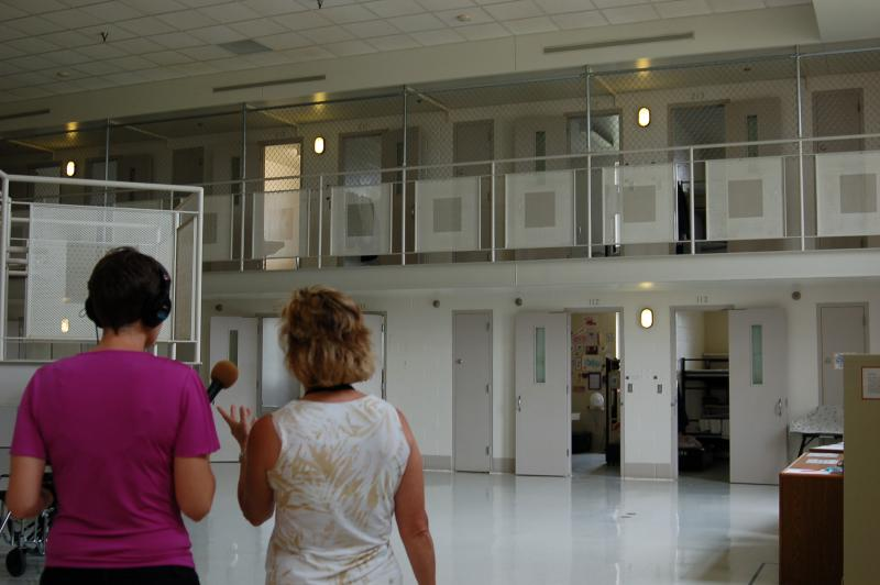 Warden Patti Wachtendorf shows IPR's Charity Nebbe around the Mitchellville Correctional Institute for Women.