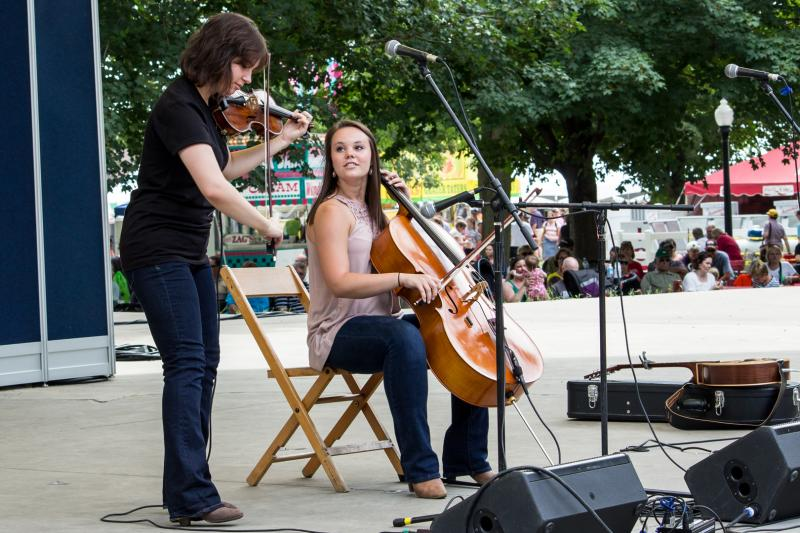 "Violinist Karla Deitmeyer and cellist Olivia Hahn perform a combination of folk, alternative rock, and modern classical music as ""The OK Factor"" at the Iowa State Fair in 2013."