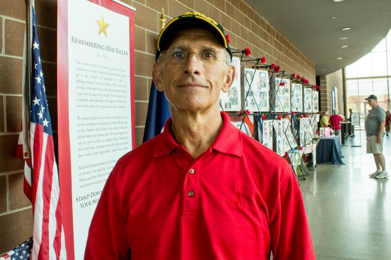 "Bob King, Executive director for the Iowa Department of Veterans Affairs stands by ""Remembering our Fallen"", a memorial dedicated to honoring Iowan veterans during its visit to the Iowa State Fair."