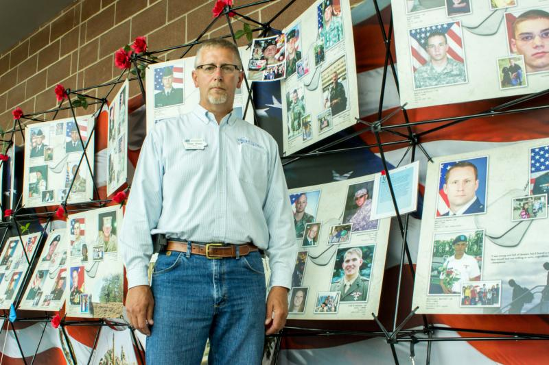 "This year the Iowa State Fair selected Dean Kluss, a farmer from Clarion, as one of the Iowans of the Day. Kluss is also a 20 year Navy veteran and after he visited the memorial ""Remembering our Fallen"", he says it makes being Iowan of the day seem small."
