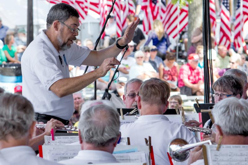 Conducted by James Goodwin, the Iowa Military Veterans Band performs on the Susan Knapp Amphitheater stage during the 2013 Iowa State Fair.