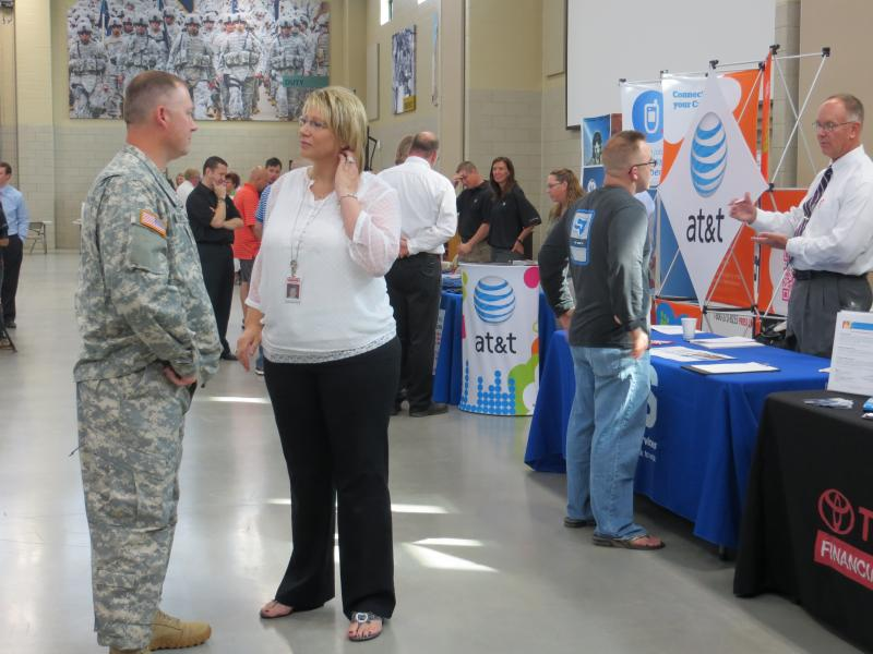 Veterans chatted with employers at the National Guard Armory in Cedar Rapids.