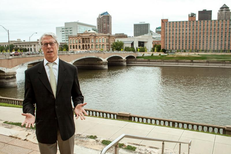 Des Moines Mayor Frank Cownie stands by the Des Moines River in the city's downtown.