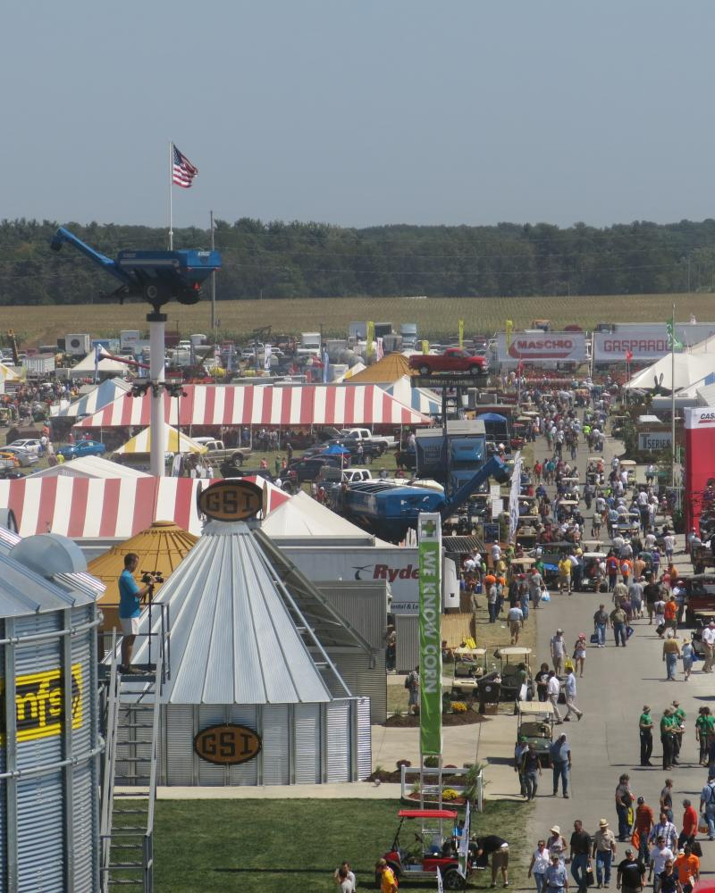 Visitors stroll through exhibits at the Farm Progress Show in Decatur, Ill.