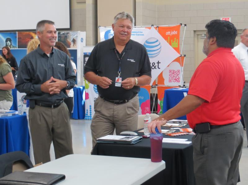 "Employers chat at the ""Hiring our Heroes"" job fair in Cedar Rapids."