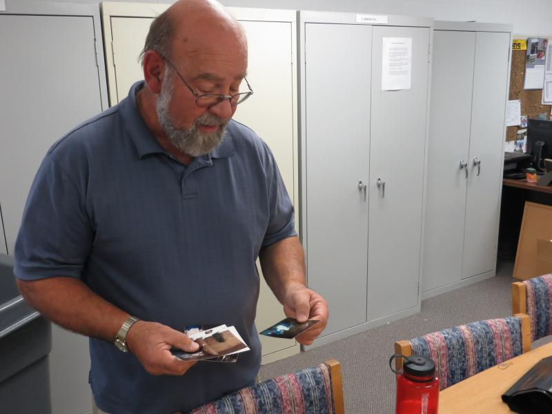 Activities Director Rich Keenan goes through old photographs from the 32 years he's worked at the Abbe Center.