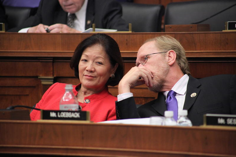 Representative Dave Loebsack (D-IA) and Representative Mazie Hirono (D-HI) share a comment while listening to debate on the America's Affordable Health Choices Act.