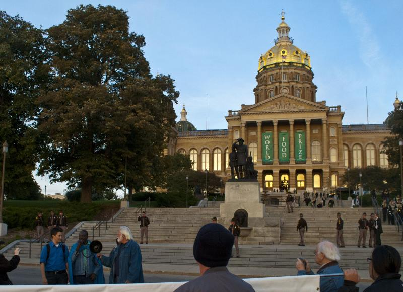 Protestors gather on the west side of the Iowa State Capitol to protest the laureates.