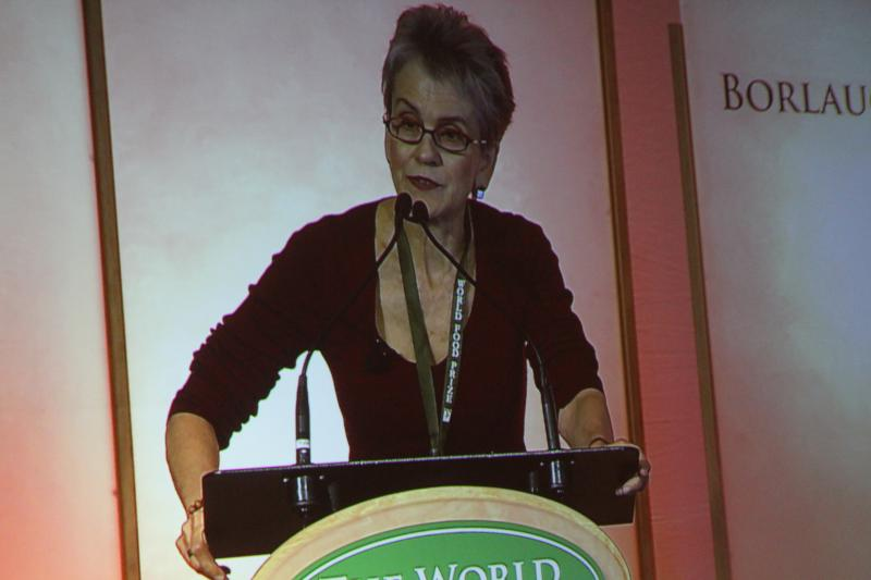 Anti-GMO activist Frances Moore Lappe, as seen on screen, addresses a group at the World Food Prize Borlaug Dialogue in Des Moines.