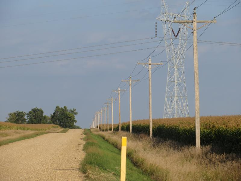 The proposed transmission line would dwarf existing powerlines near the converter station site.