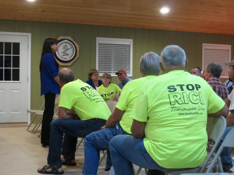 "Landowners in ""Stop the RICL"" t-shirts gather in Palo Alto county."