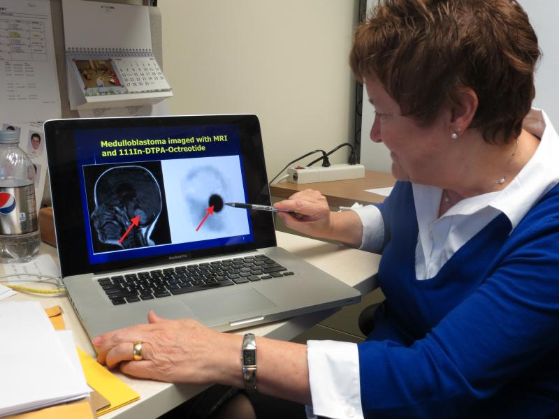 Dr. Sue O'Dorisio shows an image of a patient's brain after treatment with an imaging agent.