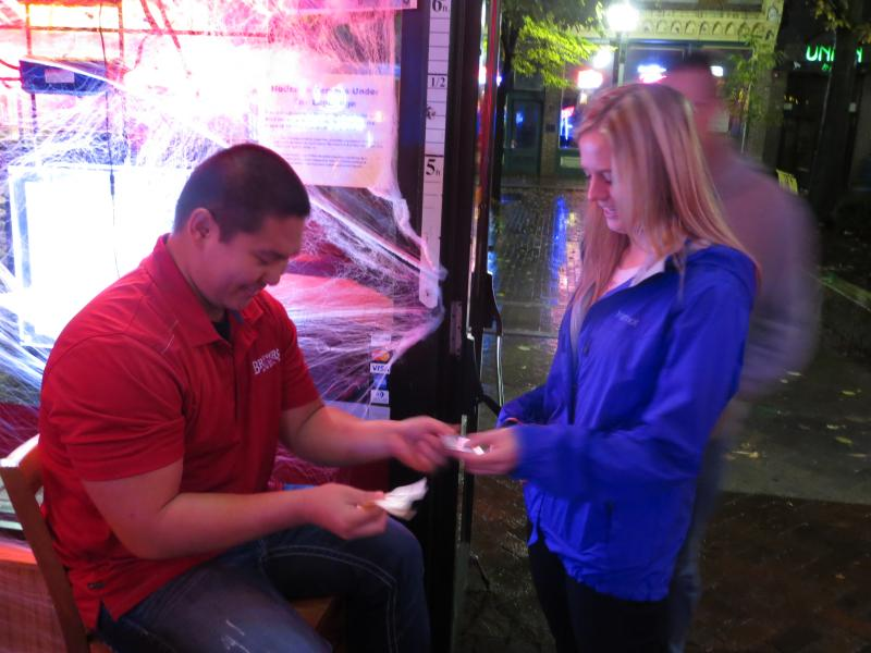 Jake Park checks ID's at a bar in downtown Iowa City.