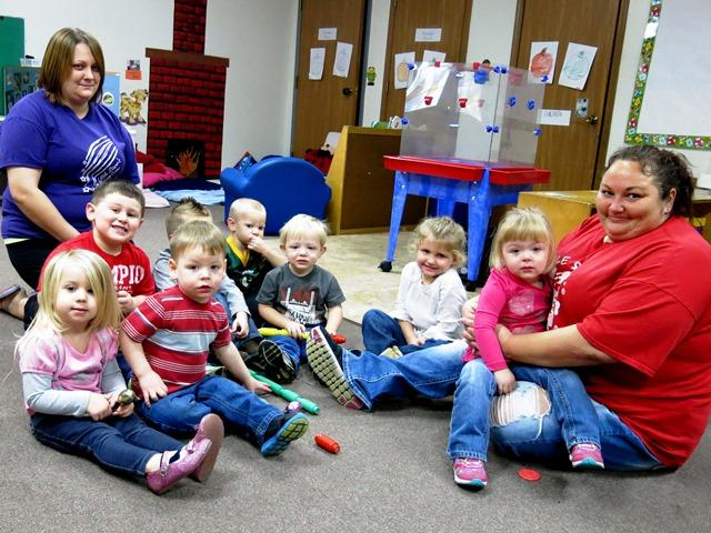 SNAP recipient Becky Miller (far right) earns just above minimum wage caring for toddlers and infants at Little Starr's Learning Center in Sandoval, Illinois.