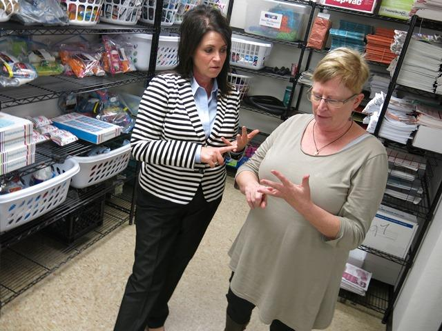 Superintendent Keri Garrett (left), of the school district that includes Marion County, Ill., speaks with Kathy Donnelly, the truancy officer, about donated items for children.