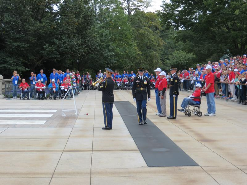 Iowa veterans view the changing of the guard and a wreath laying ceremony at the Tomb of the Unknown Soldier.