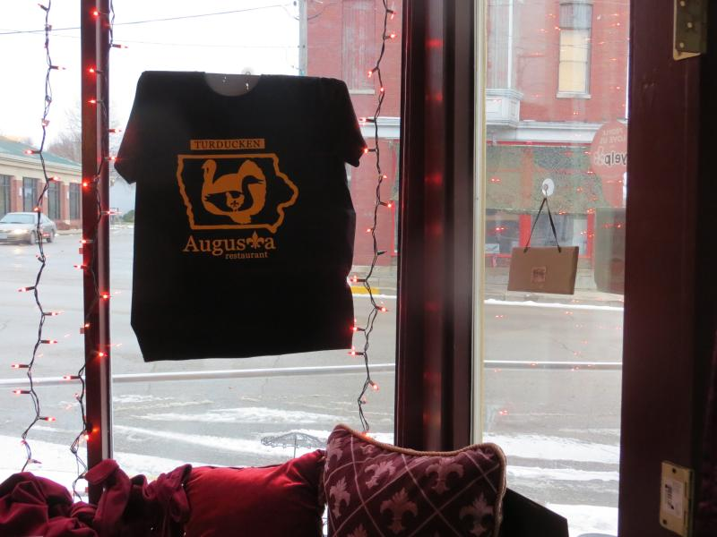A turducken-inspired t-shirt hangs in the dining room window.