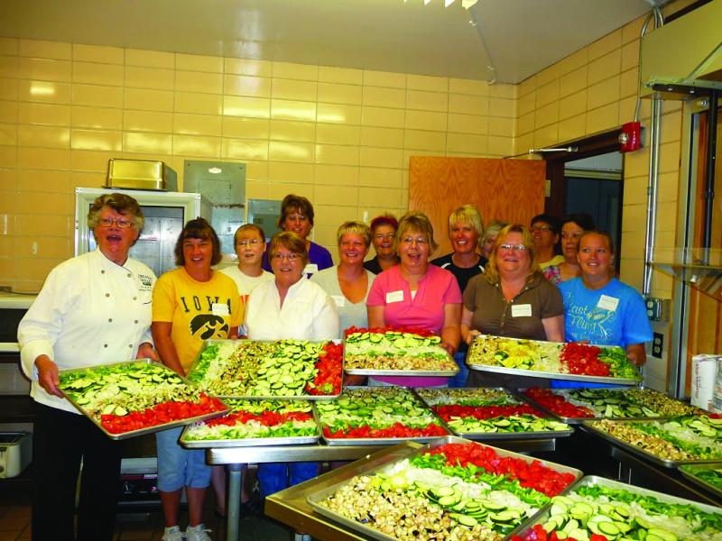Participants at the 5th Season Ratatouille Workshop at South Winneshiek High School display fresh local proudce.