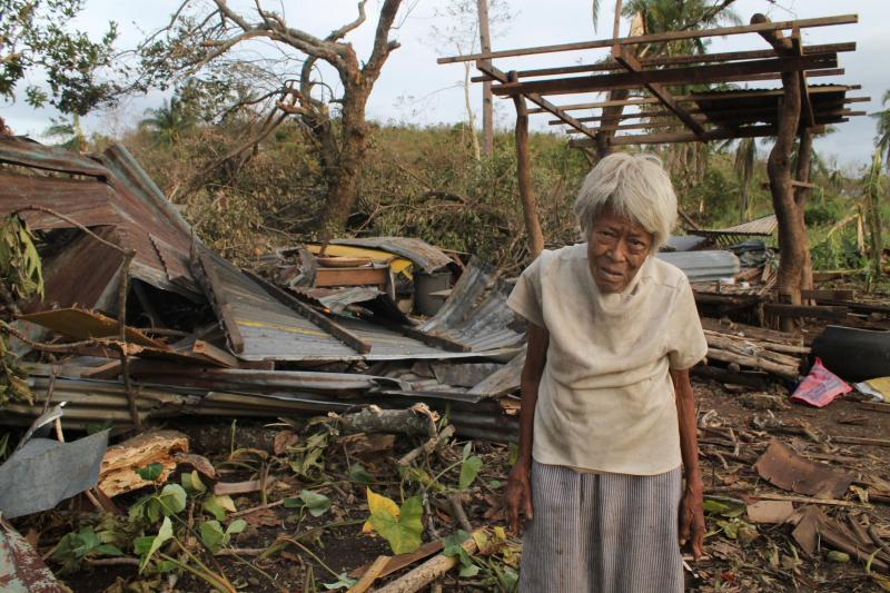 Nemesia Tipait (81) was buried under the rubble of her house when it collapse during the typhoon in Barangay Kayang, Bogo City, Cebu. Neighbors rescued her and hope to rebuild her hut.