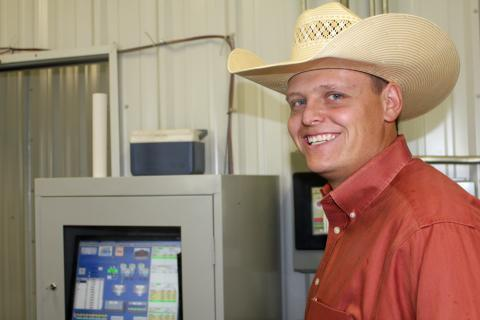 Tyler Karney manages of Ordway Cattle Feeders. In the feedlot's central computer room, digital read-outs synchronize feeding blends.