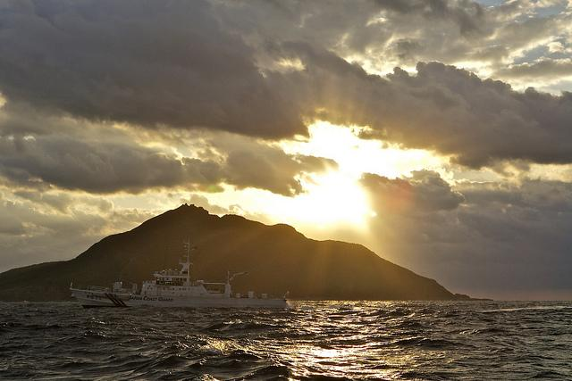 A Coast Guard patrol vessel passes by Uotsuri, the largest island in the Senkaku/Diaoyu chain.