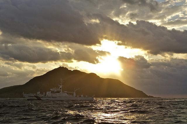 A Coast Guard patrol vessel passes by Uotsuri, the largest island in the Senkaku/Diaoyu chain.