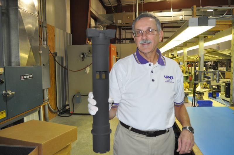 On the production floor, CEO Gary Roling shows off a crosswind sensor used by the U.S. military.