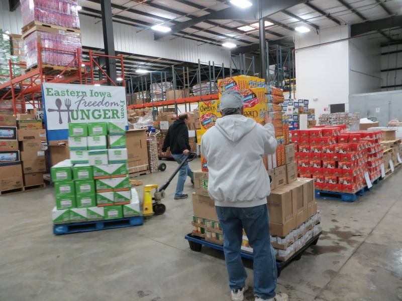 At the Hawkeye Area Community Action Program's food reservoir warehouse, employees pack a van destined for a North Liberty food pantry.
