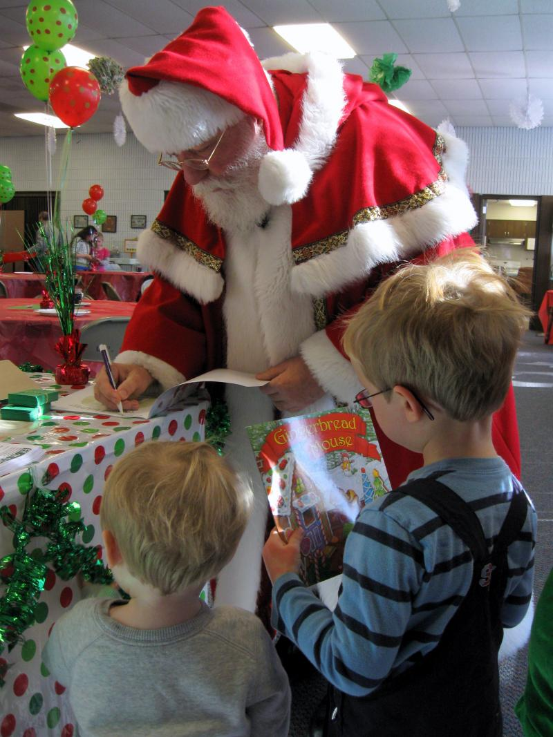 Santa's Helper Dave Stoufer signs children's Christmas-themed books