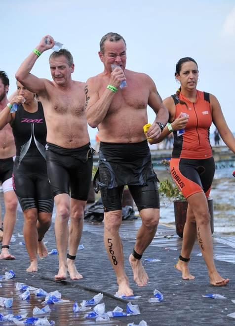 61-year-old Iowa City resident John Little running in his 13th Ironman Triathlon in Cozumel, Mexico.