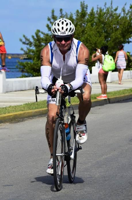61-year-old Iowa City resident John Little biking in his 13th Ironman Triathlon in Cozumel, Mexico.