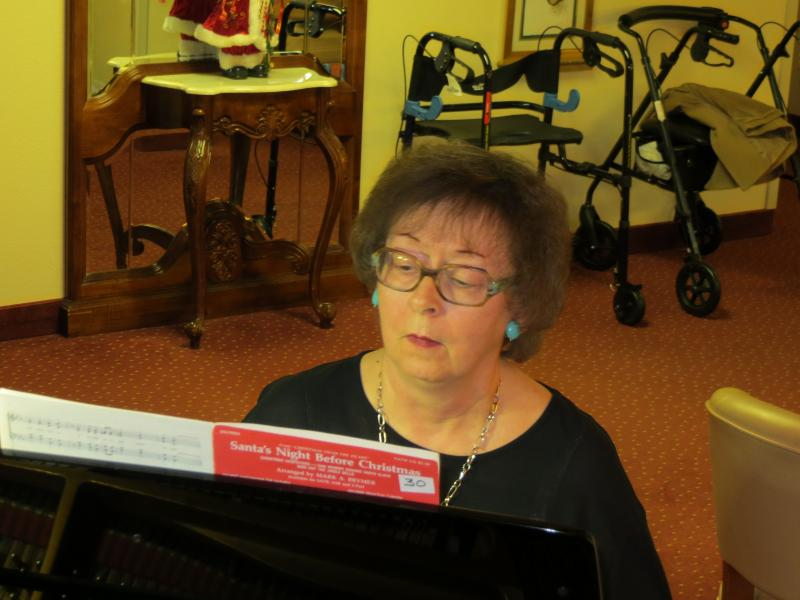 Pianist Kay Rothert is Principal's oldest tenured employee at the home office.