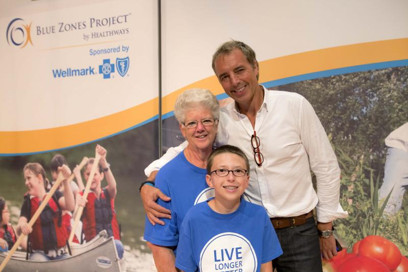 Blue Zones participant Lynn Stansbery with Dan Buettner and her grandson Cody at the Blue Zones Project kickoff event in Cedar Rapids