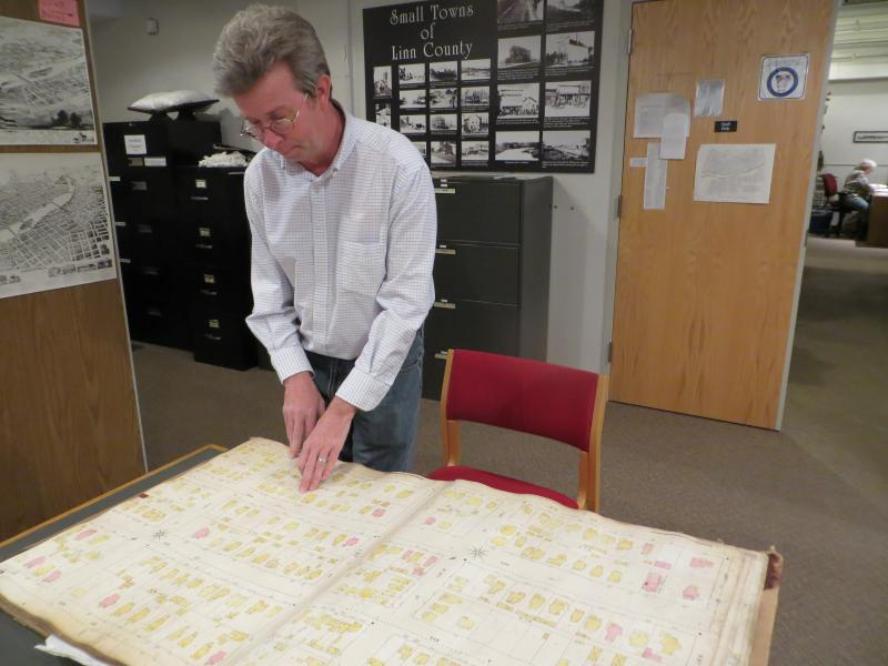 Linn County historian, Mark Stoffer Hunter, points to the Brewer House on a historic map once used by firefighters.