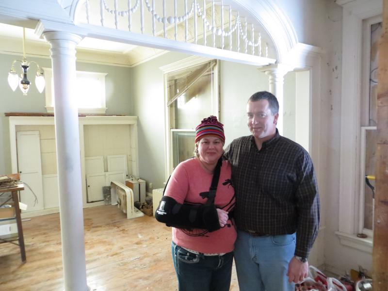 Dawn Stephens and Greg Young, of Cedar Rapids, stand in the foyer of the historic home they are restoring.
