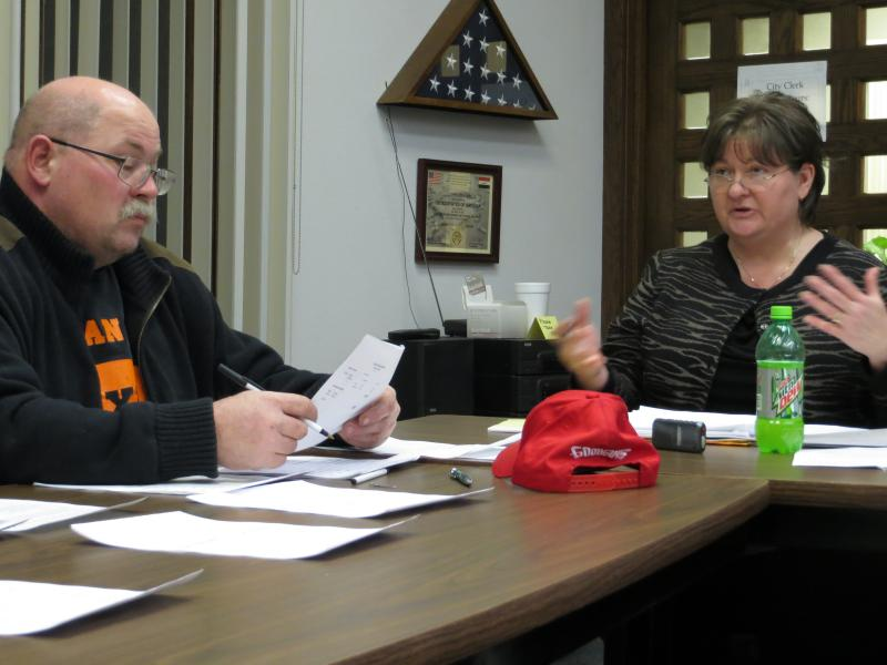 Laurel mayor Larry Atchen and City Manager Lynne Gummert discuss the town's budget at a city council meeting.