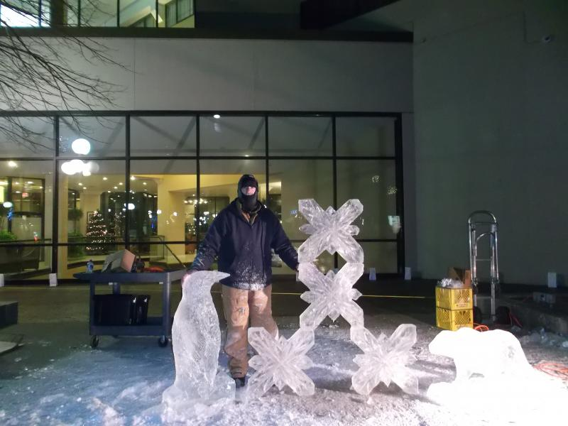 Ice sculptor Ron Hall at the 2013 Iowa City Winterfest